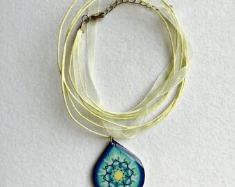 Necklace with Finnish resin pendant on silk cord