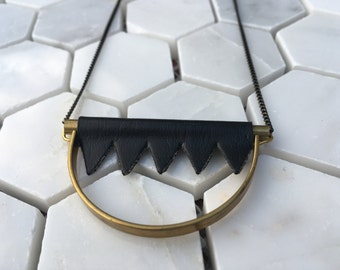 PLEASE ME Black Vinyl with Brass Half Circle Necklace with Black and Gold Faceted Chain