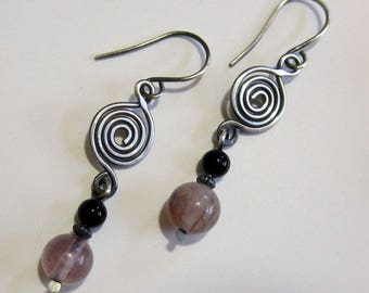 Silver spiral earrings with purple and black beads
