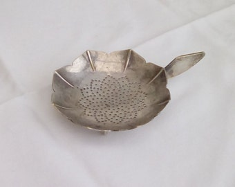 Vintage French or Swiss tea strainer.