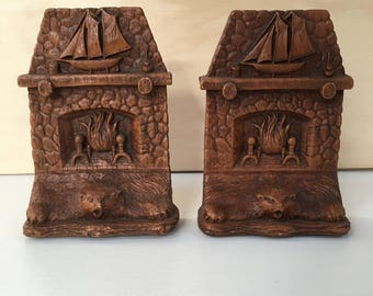 Bookends - Stone Fireplace With A Sailboat Model and Bear Rug - American 1940's