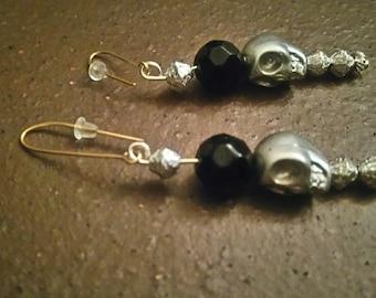 Silver and black skull earrings