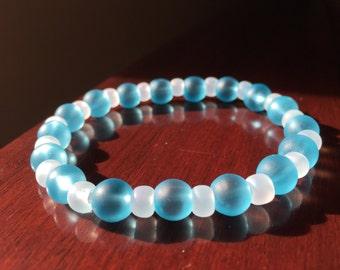 Sea glass, sea glass bracelet, blue sea glass, bead bracelet, stretchy bracelets, charity bracelets, proceeds to charity, profits for paws.