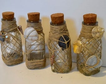 Handmade shells and twine mini glass containers