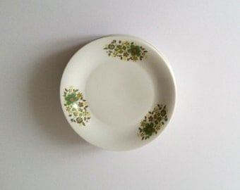 Unique retro plate(s) with green and brown flowers