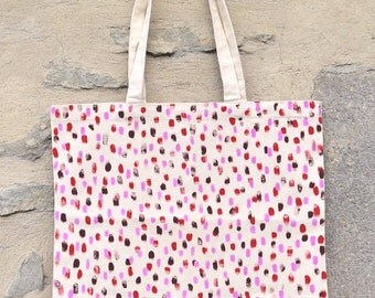 Tote painted cotton bag has hand.