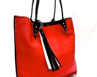 Red leather bag with black edges and tassels in white and black - handmade!