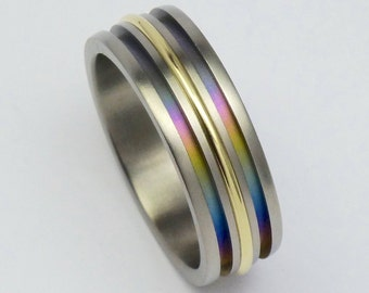 Rainbow colors anodized titanium and 14 carat gold ring size 19mm. Anodized titan, gold ring. Titanium, gold jewelry.
