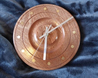 Handturned sapele wood clock with solid brass inlay.