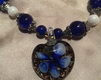 Blown glass navy blue heart pendant