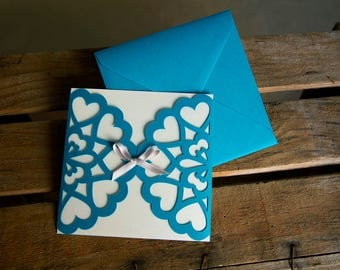 Turquoise hearts with bow wedding invitation