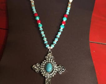 Turquoise and Rhinestone Cross on turquoise and red beads!