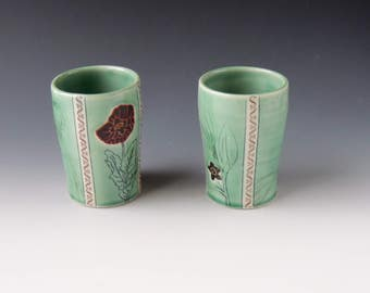 Ceramic Poppy and Coca Leaf Tumblers - green porcelain clay cups with flowers, leaves, seedpods, and decals - wheel thrown handmade pottery