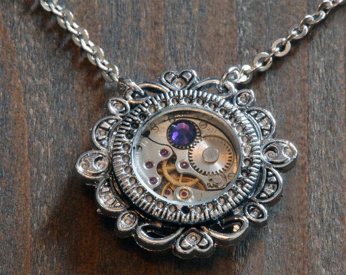 Steampunk Jewelry - Pendant - Watch movement and purple velvet