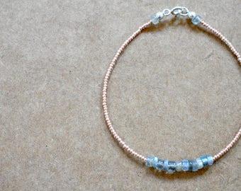 labradorite bracelet with rose gold seed beads. labradorite heshi string bracelet. thin stackable. labradorite seed bead jewelry. minimalist