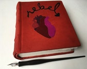 Rebel Heart Journal, leather case-bound journal with red goatskin, multimedia paper, leather onlay, block printed papers