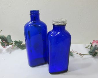 Cobalt Blue Glass Medicine Bottles Set of 2 One has Metal Lid