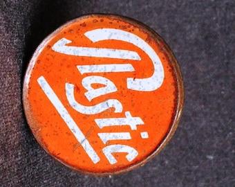 The very little vintage round Plastic orange tin box.
