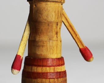 Folkart Version of Classic Man In Barrel Novelty