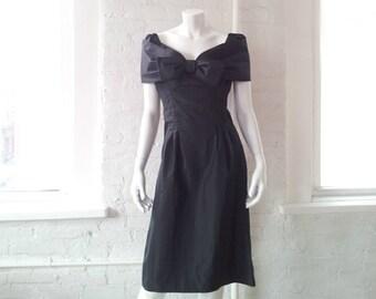 Black Cocktail Dress 1960s Vintage Wiggle Dress Shelf Bust Bow Off Shoulder Portrait Collar Oggee Rizkalla Small 1950s Bombshell Prom Dress