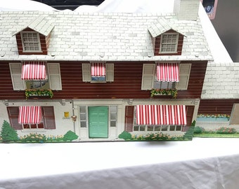 Louis Marx Marxie Mansion  Two Story with Patio Tin Litho Dollhouse with Florida Room and Awnings 64 Pieces Furniture