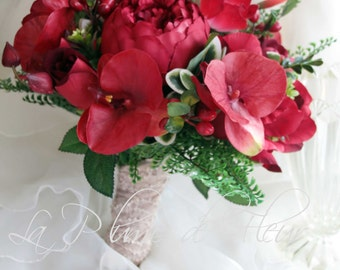 Lush red wedding bouquet.  Real touch anemones, orchids, silk roses, gladioli, berries and lush foliage.  Real touch  and silk flowers