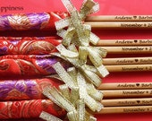 For Priscilla: Customised engraved chopsticks in Chinese brocade sleeves (130 pairs)