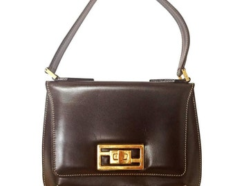 Vintage FENDI genuine dark brown leather handbag with golden FF logo at closure. Rare masterpiece