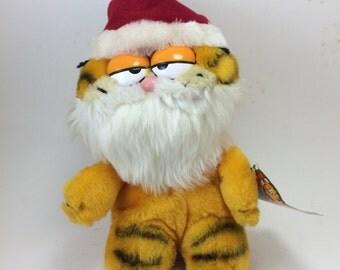Garfield Santa  fat little plush white beard red pompom hat gift tag 80s plush toy orange tabby