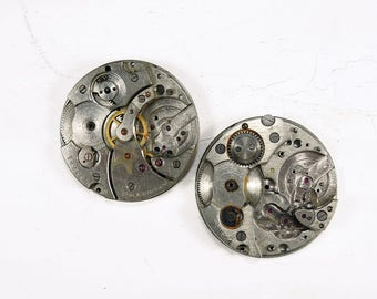 Old pocket watch movement - set of 2 - c57