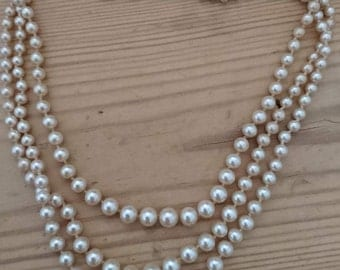 Vintage three strand pearl necklace with sterling silver clasp