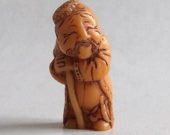 vintage old man resin figurine