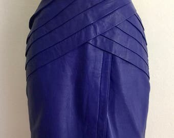 Vibrant 1980s purple leather pencil skirt with folded asymmetric front hip panels