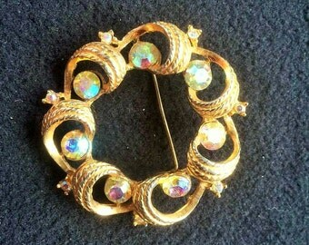 Beautiful sparkling  auroroa borealis crystal rhinestones  on a spiral textured gold  brooch