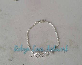 Curved Silver DNA Double Helix Spiral Bracelet on Silver Crossed Chain. Anatomy, Anatomical, Costume, Doctor, Science, Biology