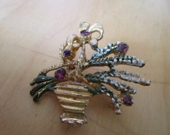"vintage goldtone heather brooch 1.75""high with white/green enamel with dark stones in purple,brown"