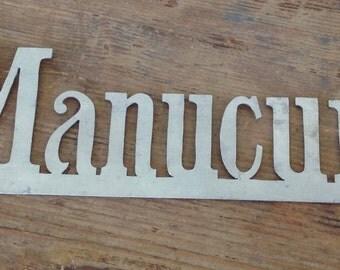 Manicure ( manucure in french) cut in a zinc sheet