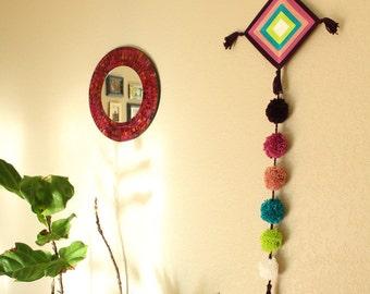 Consciousness, a handmade Ojo de Dios Mandala with pompoms