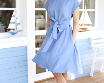 Women dress with wide skirt and waist ribbon. Loose dress with side pockets and separately belt.