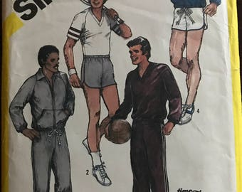 Simplicity 5565 - 1980s Mans Stretch Knit Track Suit and Sports Collection with Jacket, Hoodie, Top, Pants, and Shorts - Size Large 42 44