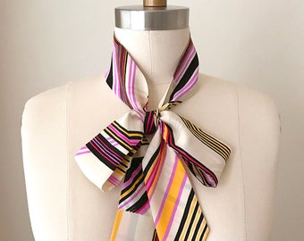 "Silk skinny scarf in a statement stripe is 53""x2"" and so versatile. Wear it as a choker tie, headscarf, sash or in a classic bow."