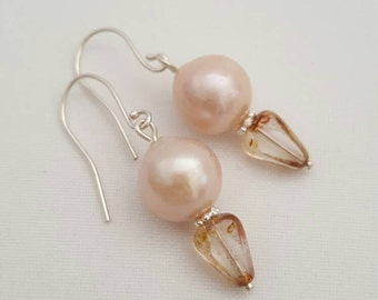 Pale pink pearls and Czech glass earrings. Drop pearl earrings on sterling silver. Modern style pale pink pearl earrings featuring.