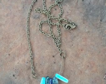 Shell and blue iris rock crystal necklace