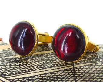 Vintage authentic old school cufflinks by Swank. Deep red cabachon with gold setting. Squared hardware