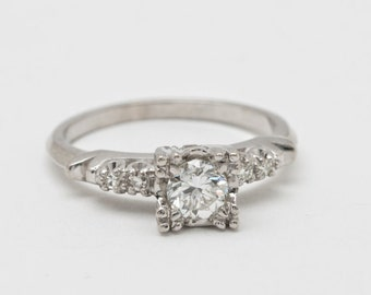 Estate Vintage Engagement Ring Floating Diamond Center Design With a Clean White and Sparkly .35 Carat Diamond 14 Kt White Gold US Size 5.5