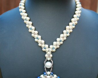 Unique handmade Beaded Necklace with blue Swarovski Bicone and round Pearl beads