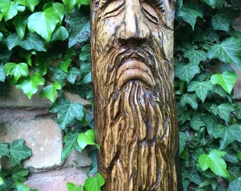 A hand carved Mountain man type character