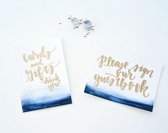 watercolor gold handwritten wedding table signs with custom lettering // silver cursive handwriting calligraphy font for wedding decor