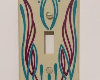 Custom pinstriped plastic ivory wallplate