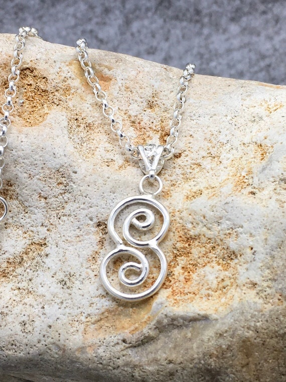 Handcrafted Sterling Silver Swirling Pendant Necklace.